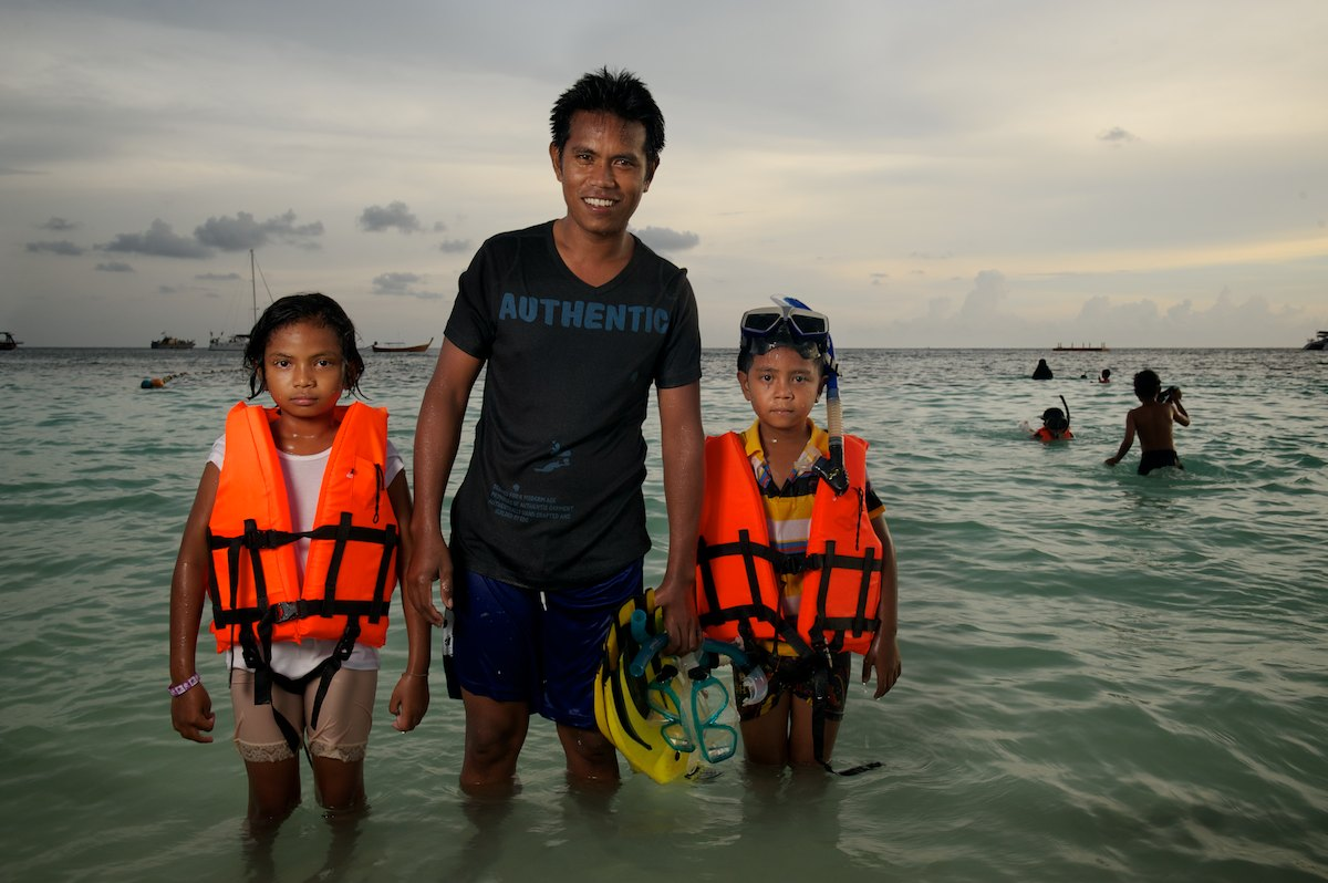 A family on holiday from Koh Muk, Thailand. Pattaya Beach - Koh Lipe, Thailand
