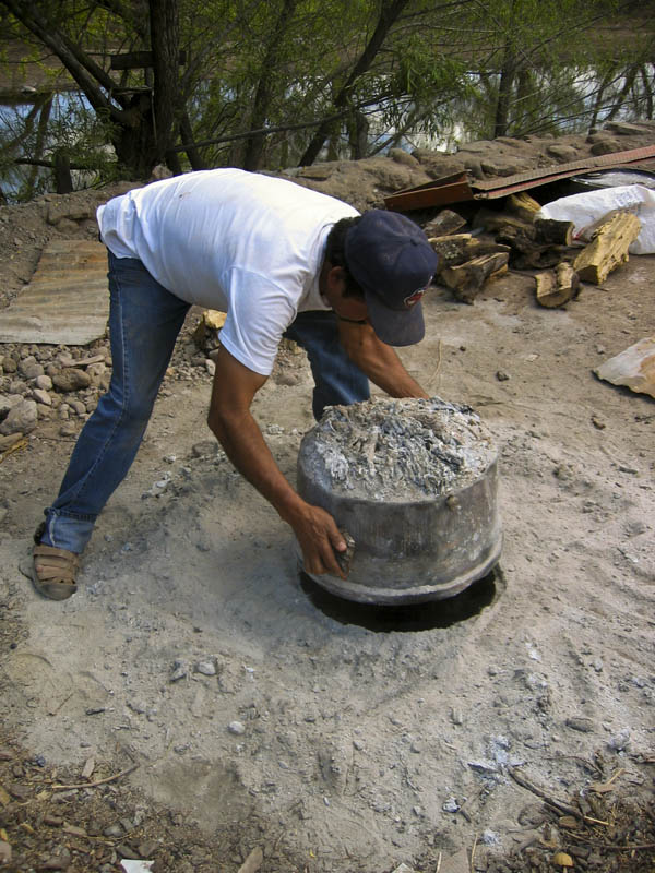 Potter completing a firing in Mata Ortiz