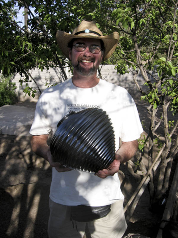 A happy collector of pots in Mata Ortiz