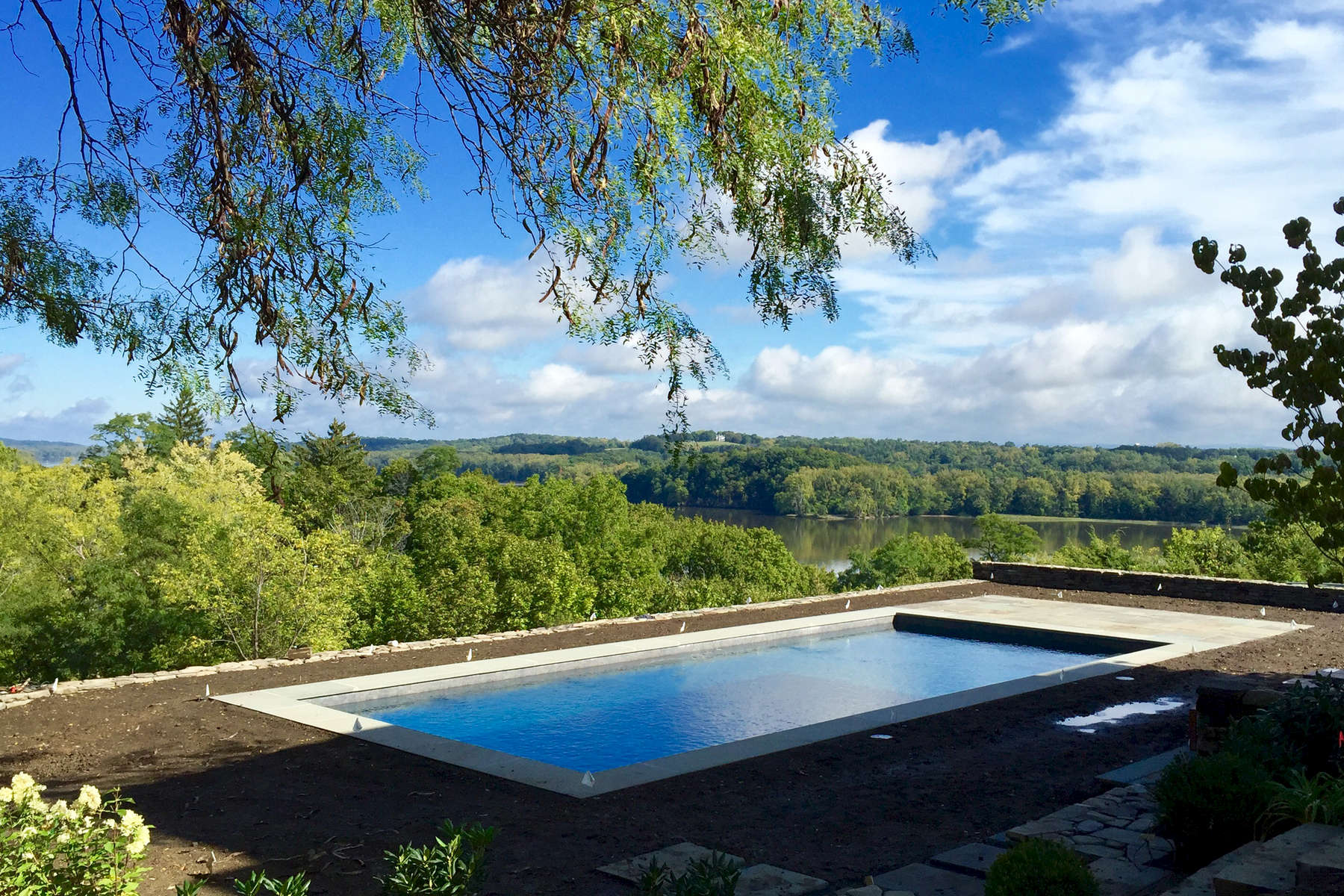 The renovation of this Historic property includes a new pool terrace set into the hillside to take advantage of the beautiful views to the Hudson River.