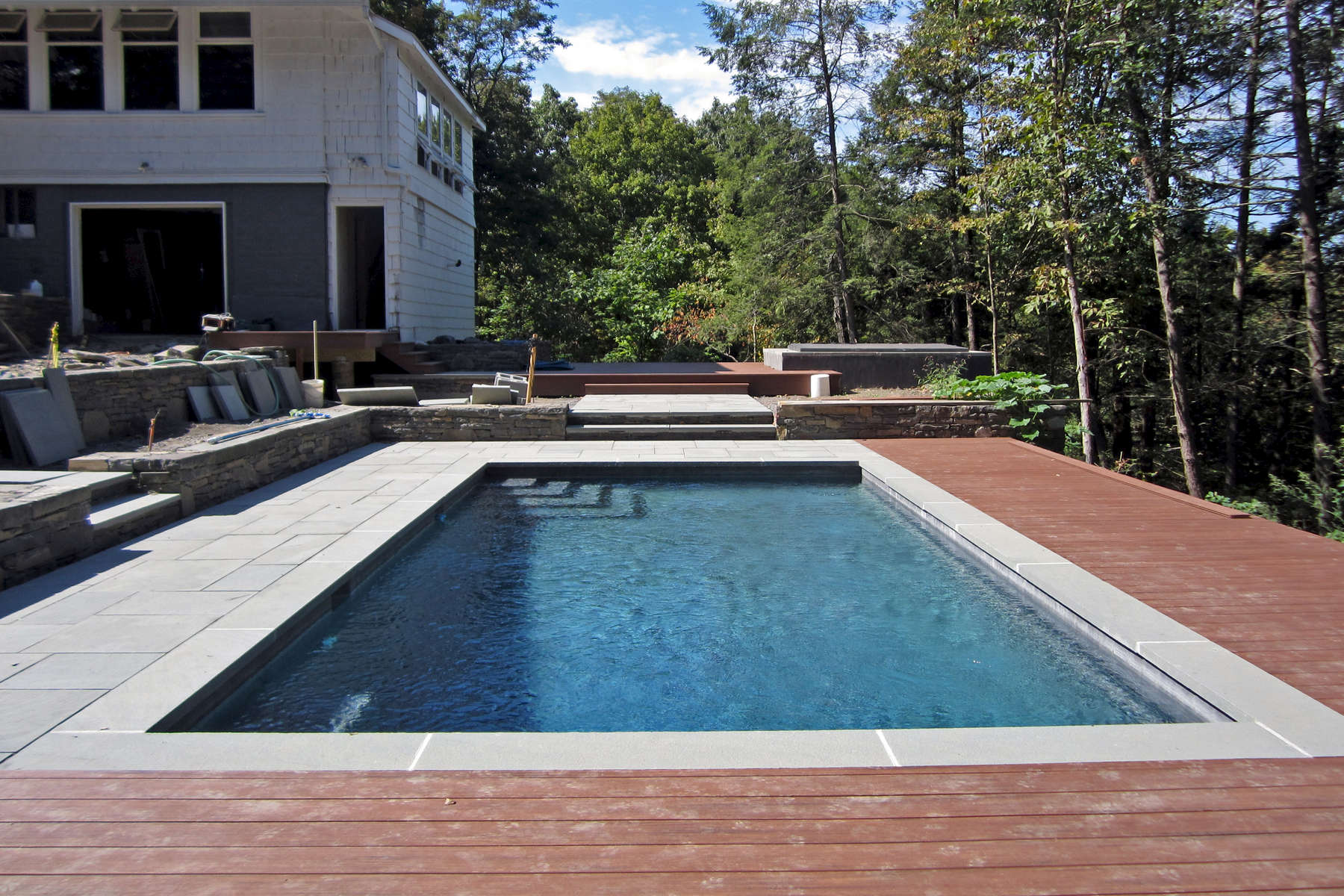 The outdoor rooms are defined by stonewalls, bluestone patios, wood decks and future garden plantings.
