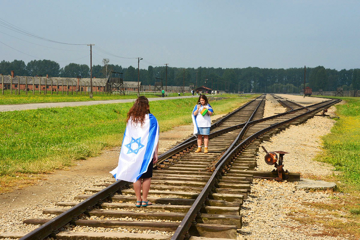 Jewsih girls on tracks at Auschwitz camp, Ploand