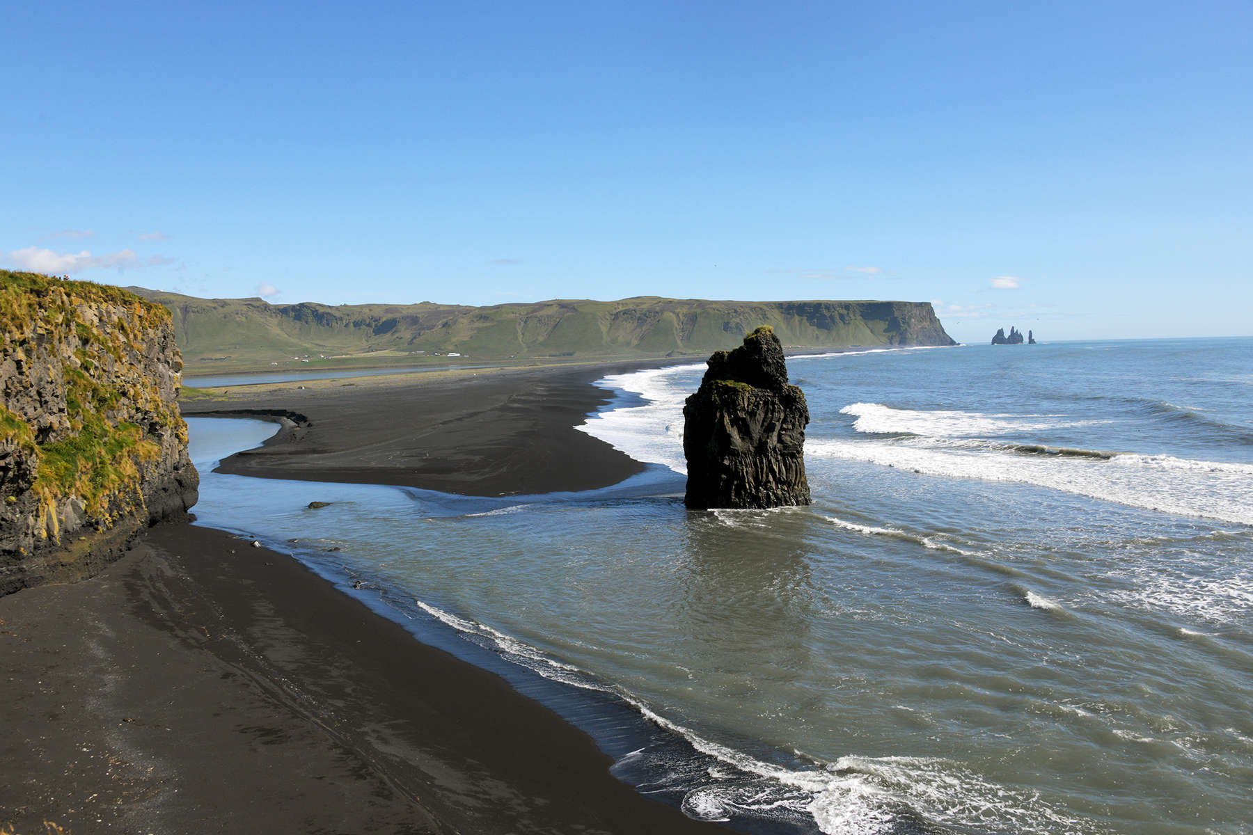 This is a photo of the beautiful black volcanic sand beaches in Vik, Iceland.