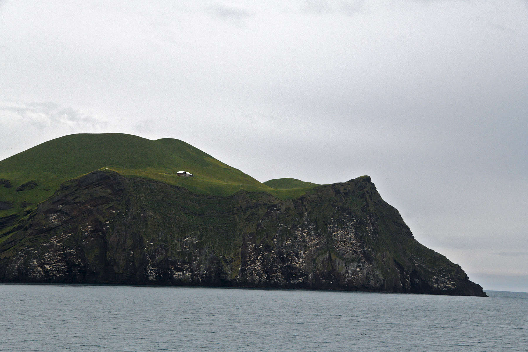 This is a photo of a hunting lodge on an uninhabited island in the Westman Island chain, located off the coast of Iceland. Sadly It is used to catch Puffins.