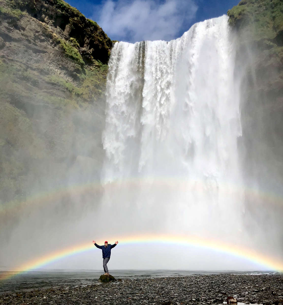 This is the waterfall at Skogar in Iceland. I walked out into the river on a rock and had a friend shoot the image. A rainbow appeared at the right time!