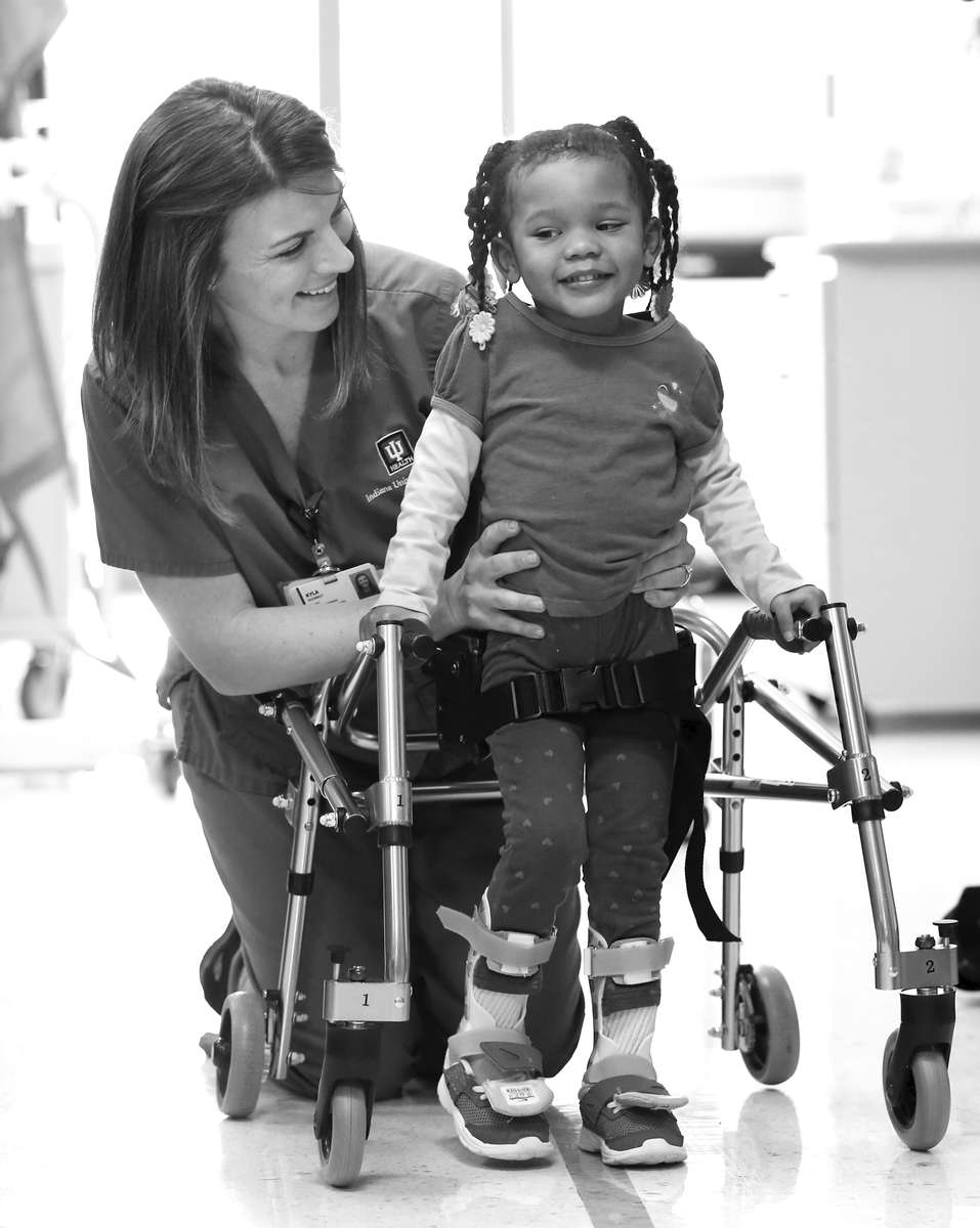 Riley Patient Ariael Vega, 3,  works with Physical Therapist Kyla Schmidt during her therapy session at Riley Hospital for Children.