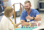Occupational Therapist John Radzak works with a patient at IU Health Bloomington.