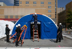 April 06, 2020. COVID Coverage. Medical tents are erected outside IU Health Methodist Hospital Emergency Department Monday April 6, 2020. The tents are equipped with negative airflow, water, power, and can hold 10 patients each.