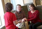 Patients Denise Ervin and Bill Hobbs talk to nurse Carey White at the IU Health Simon Cancer Center.