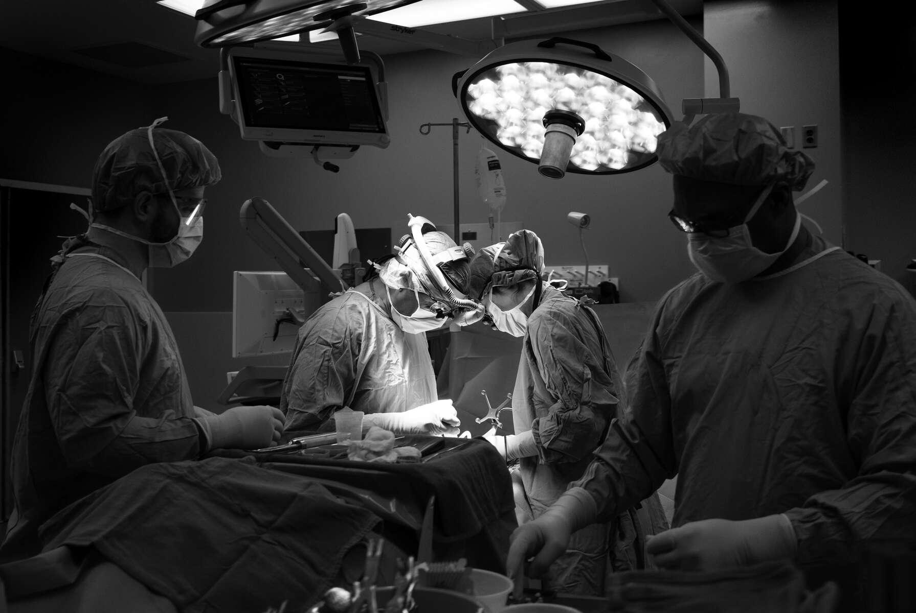 Dr. Mitesh Shah operating on a spine at IU Health Methodist Hospital.