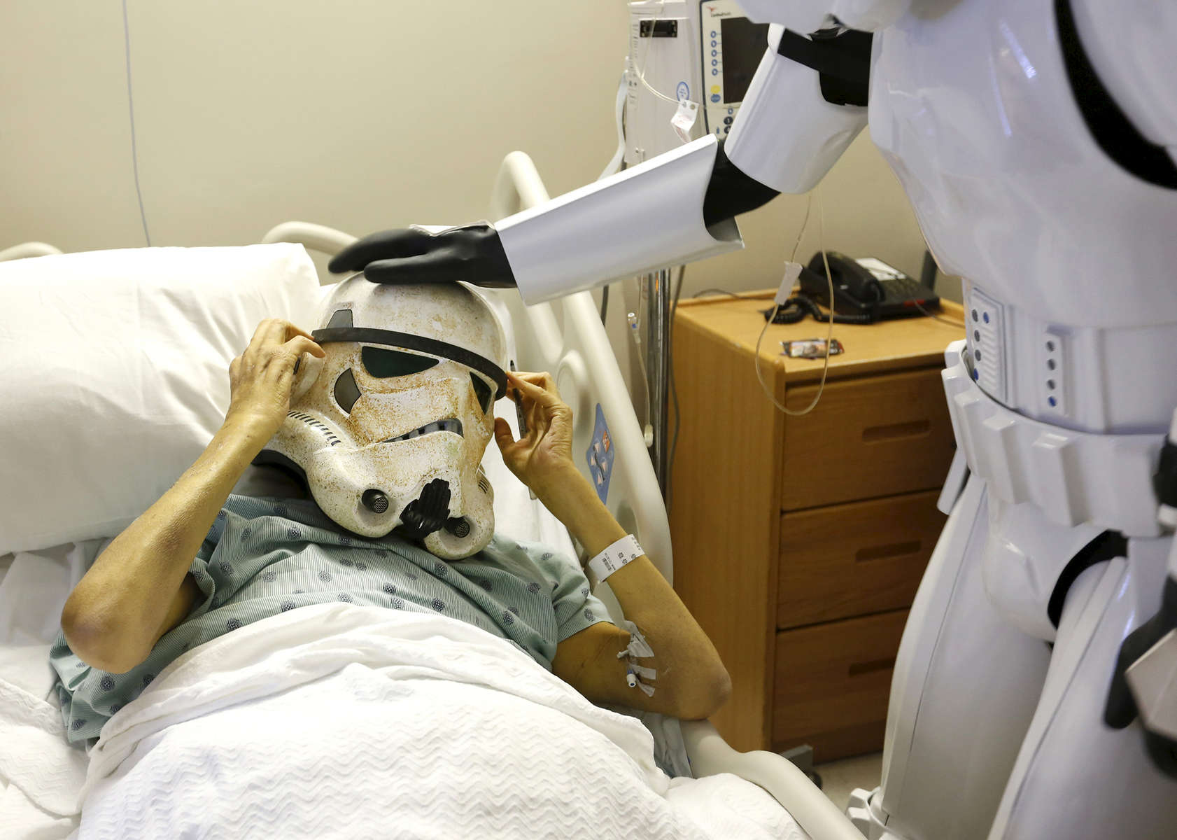 Patient Richard Dillon gets a surprise visit from Star Wars characters in his hospital room at IU Health University Hospital November 6, 2015. The surprise was carried out buy the Star Wars costume group the 501st Legion and organized by IU Health nurse Brandy Kopsas-Kingsley after learning her patient, who is in end stage liver failure, is a huge Star Wars fan.Chris Bergin/ IU Health Visual Media