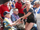 Lady Gaga jokes with a war veteran before the start of the 100th running of the Indianapolis 500 May 29, 2016.
