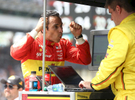 Helio Castroneves talks to a crew member following his disappointing 100th running of the Indianapolis 500 May 29, 2016.