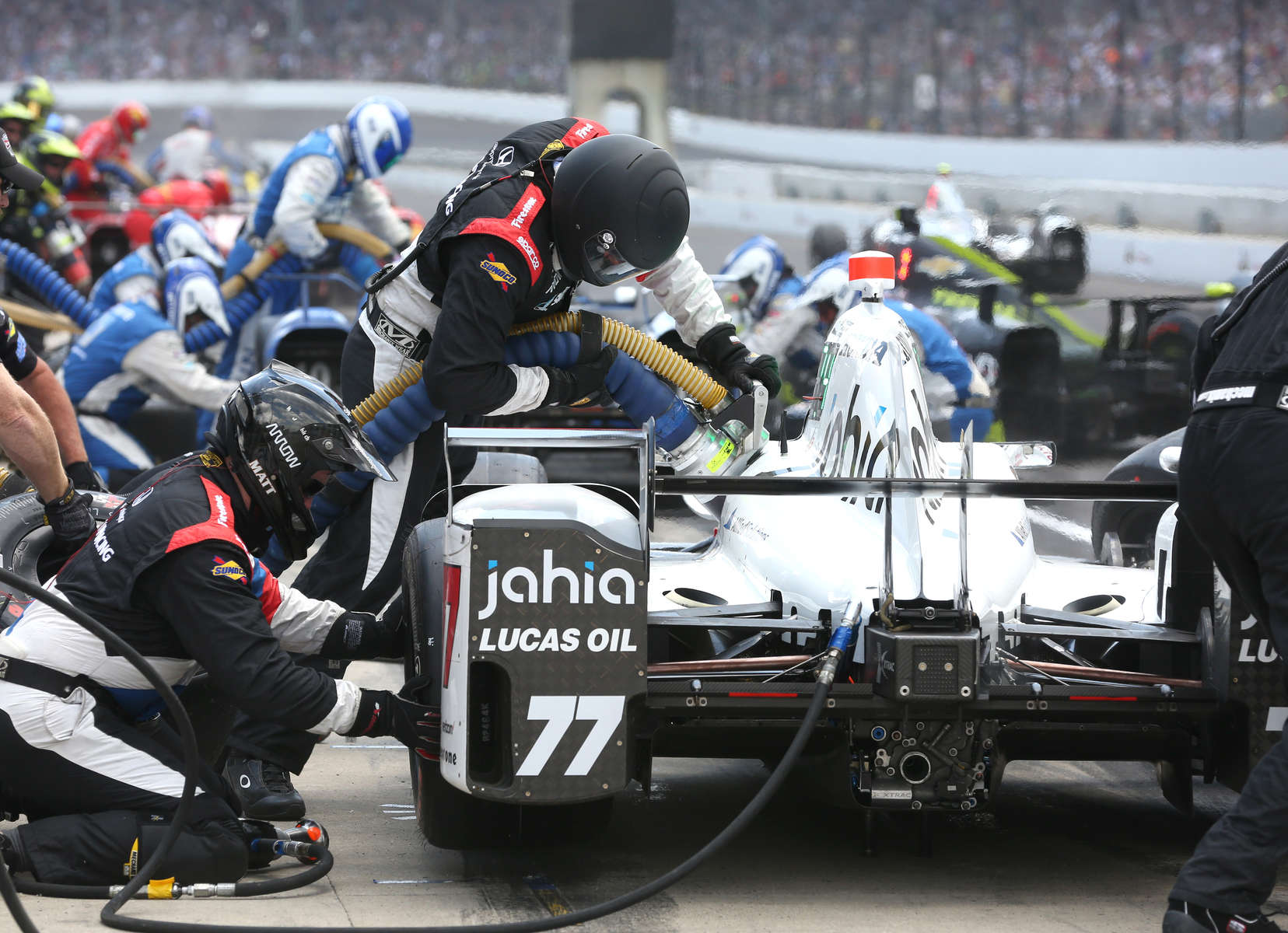 Orion Servia's crew completes a pit stop during the 100th running of the Indianapolis 500 May 29, 2016.