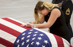Whitney Hunter mourns the loss of her husband during funeral services for Army Sgt. Jonathon Hunter at Columbus East High School Saturday August 26, 2017. Chris Bergin / for The Republic