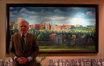 At  8' x 4', the new oil-on-canvas painted by George Delany showing off the new City of Providence, has a certain presence. The commissioned work hangs in the main lobby of a prominent firm in the city. A video can be seen on Youtube. Here, the artist stands with his newly installed work.
