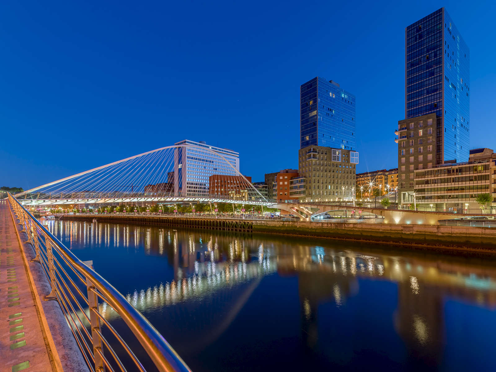 Bilbao and Nervión river. Night view