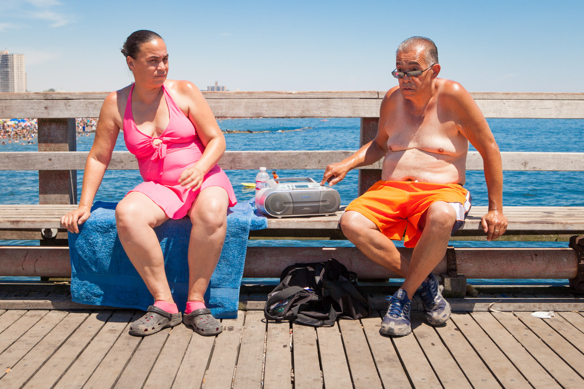 A couple listens to a portable radio along the Steeplechase Pier.