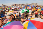 An estimated 75,000 people visited Coney Island on July 4th weekend, 2010. Beachgoers tend to crowd the area to the east of the Steeplechase Pier and directly across from the 90-year old Wonder Wheel, now a New York City landmark.