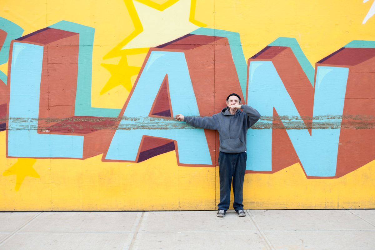 A man indicates the high-water mark along Surf Ave in Coney Island following Hurricane Sandy. November 1, 2012.