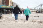 An elderly couple returns to  Brighton Beach carrying water in the wake of Hurricane Sandy. November 1, 2012.