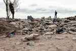 A man surveys the damage to the sea wall at the end of his street in Manhattan Beach following Hurricane Sandy. November 1, 2012.