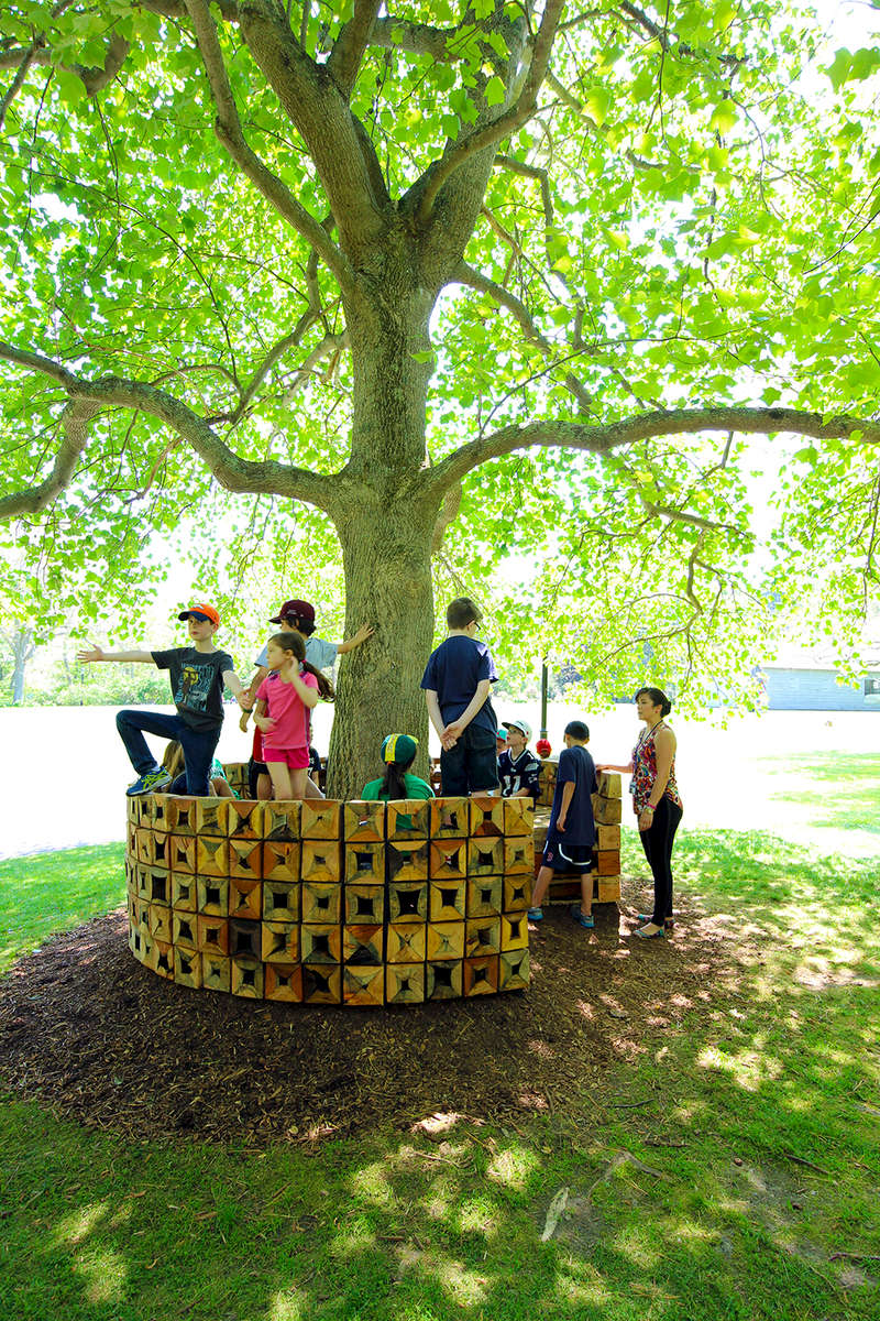 IKD recently installed Outside-In, a timber installation at the Heritage Museum and Gardens in Sandwich, MA which was a winning proposal for their secret shelter exhibition. Part pavilion and part interactive furniture, Outside-In revolves around the concept of an inversion of a typical tree bench where instead of having users face away from a tree, Outside-In focuses attention toward the tree to not only creating an intimate space between user and the tree, but due to its material construction, has users consider issues of material waste and lifecycle impacts.