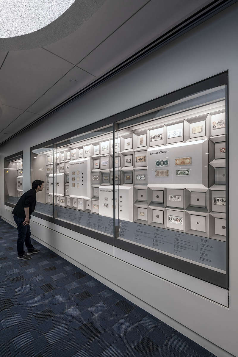 IKD oversaw the renovation, casework, and exhibit design for a US Currency Gallery in Boston, MA. Inspired by the geometry of molds for gold ingots, the historical standard of currency, the design features a field of bills and coins organized by a modular grid as a backdrop for larger display panels that feature object groupings by theme. esigned to accommodate rotating displays of varying sizes, the flexible design allows for as many or as few display panels, depending on the rotation.