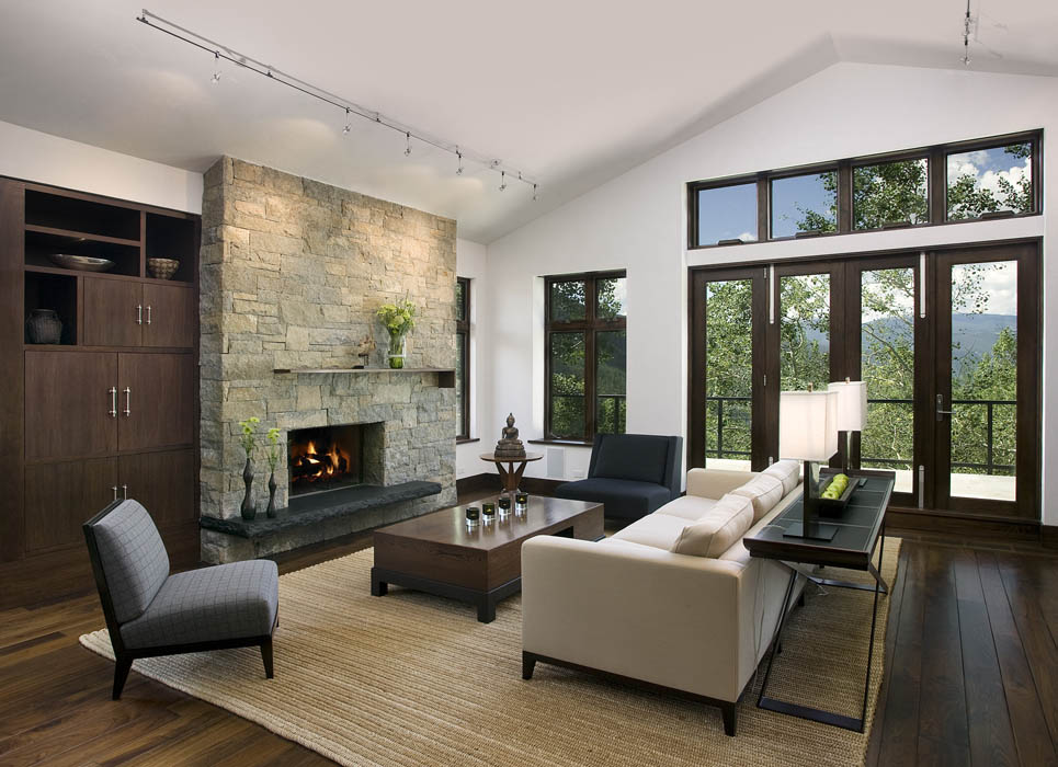 A large, stone fireplace warms the living room when gathering guests during the long, winter months...