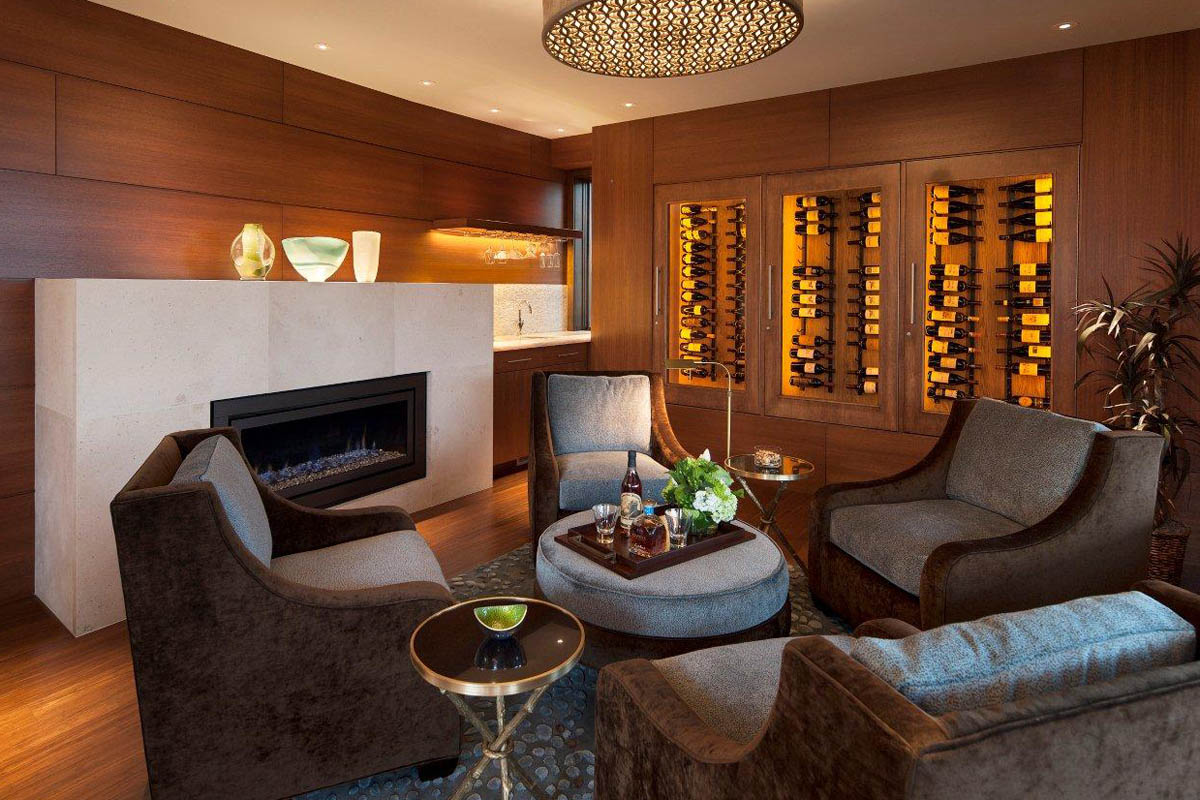 This family den comes equipped with a wine cellar, a sink, as well as a fireplace to make those cold winter nights ever more enjoyable