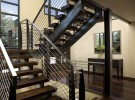 A custom staircase was designed at the main entry, giving the residence and grand entrance an open connection the other floors.