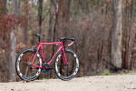 Geoff Scott or {quote}Gefsco{quote}, as he's better known, is an Australian Bike builder with a long running history and engineering. He often travels the country showcasing his well documented history of building, showing off his best built bikes which many hold world record or title records.This is the bike Geoff built for himself after successfully being treated for cancer, which is why it's painted pink. Adam at CycleEXIF featured this bike after Matt purchased it at Pushies Galore in 2015. Geoff ended up purchasing this bike back from Matt later in 2016.