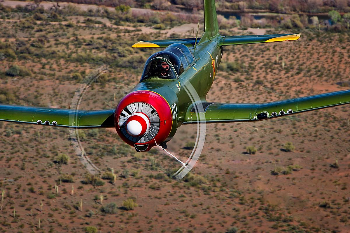 color image of a Nanchang CJ flying over the Arizona desert