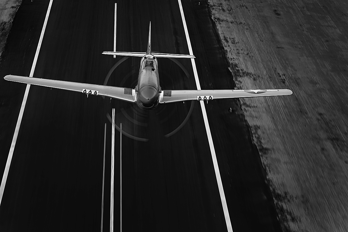 North American Mustang. Sunset flypast over runway, Mesa, ArizonaImage No: 12.004242.bw  Click HERE to Add to Cart