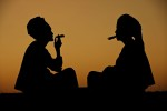 Women smoking on a hill after sunset.Bagan, Burma