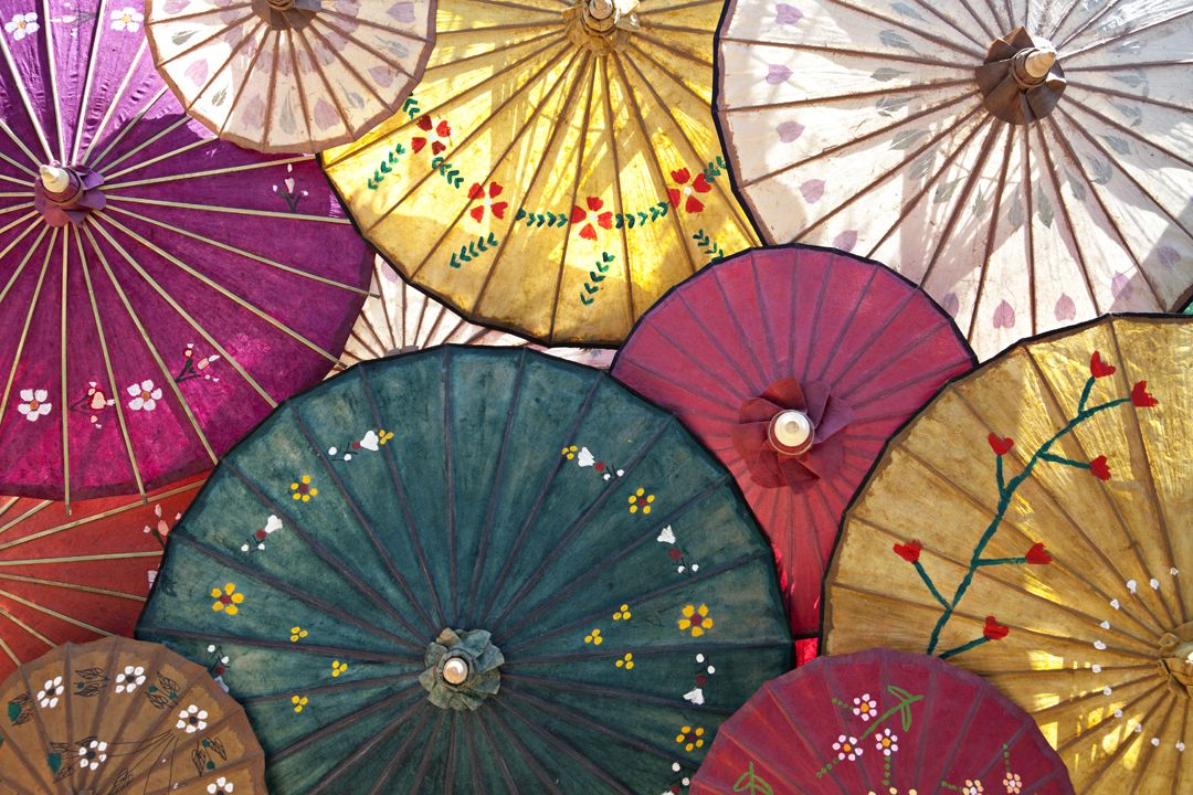 I noticed these parasols at roadside shop on the outskirts of Mandalay. I loved how the sun backlit them and brought out their color.Mandalay, Burma