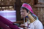 This woman belongs to a local tribe who wear rings around their neck. She weaves clothes for a living.Inle Lake, Burma