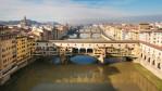 The Ponte Vecchio is a Medieval stone closed-spandrel segmental arch bridge over the Arno River, in Florence, Italy