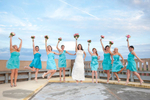Wedding party is showing there excitement by jumping for joy