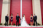 Bride and Groom with their wedding party photo outside ceremony