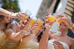Last minute champagne toast with bridesmaids before the wedding