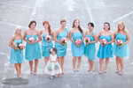 flower girl gets photo taken with bridesmaids