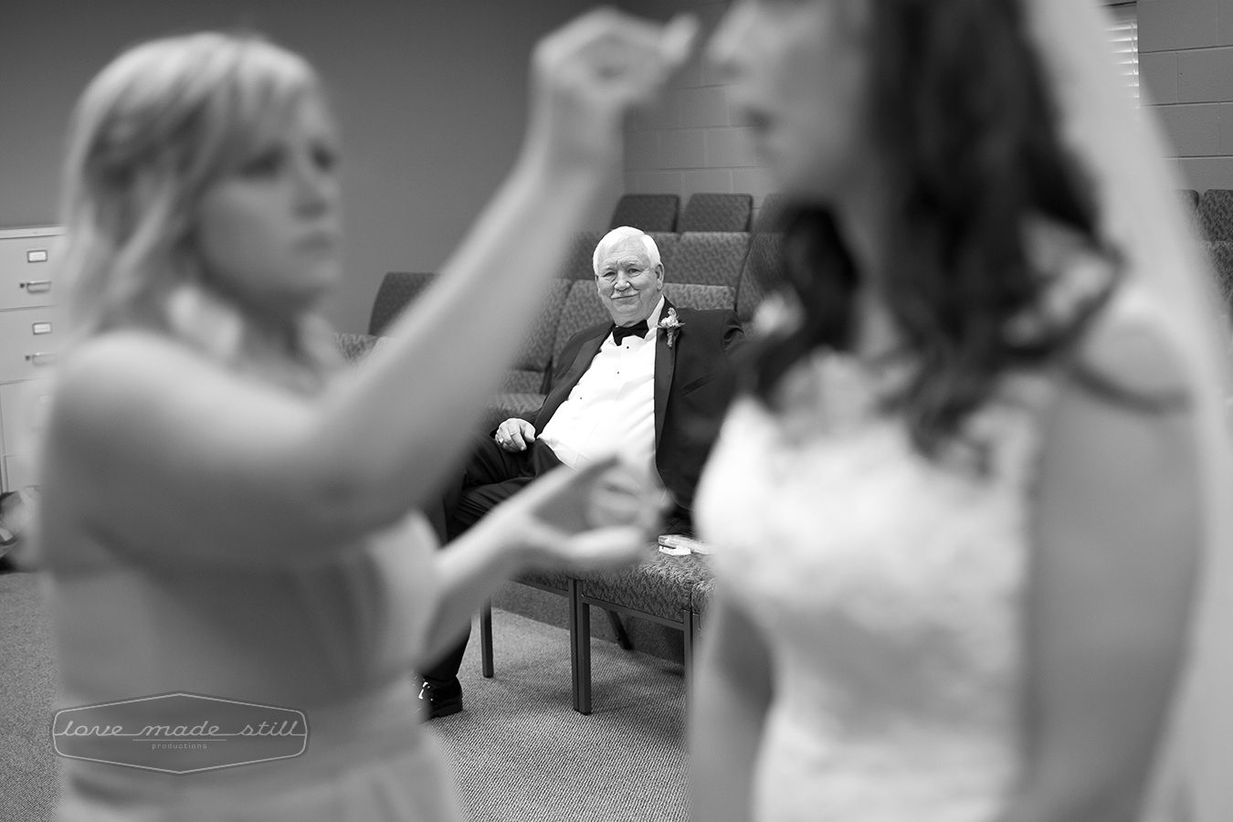 A father watches his daughter get ready for her wedding day.