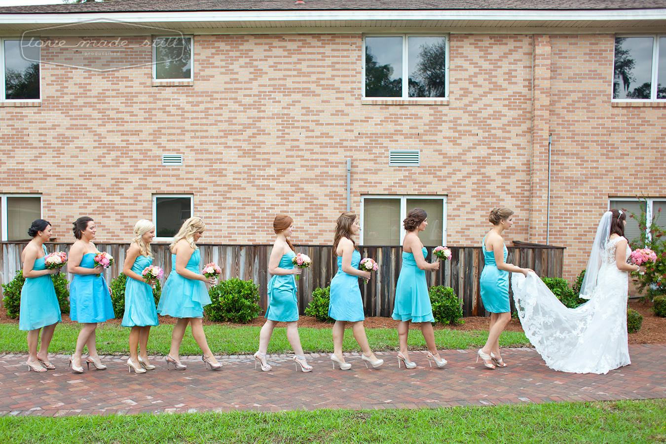 Bride enters the church in single file with bridesmaides