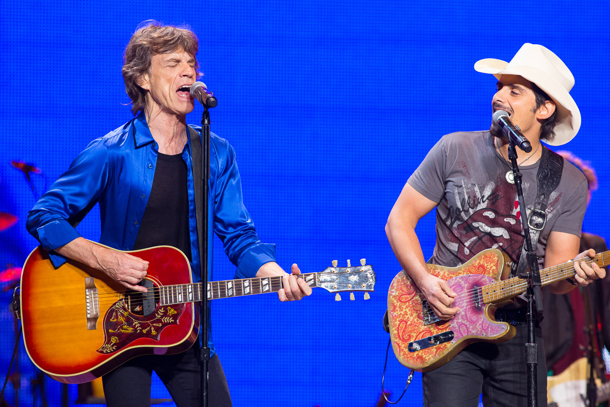 Mick Jagger of The Rolling Stones, left, performs with Brad Paisley at the Wells Fargo Center in Philadelphia.