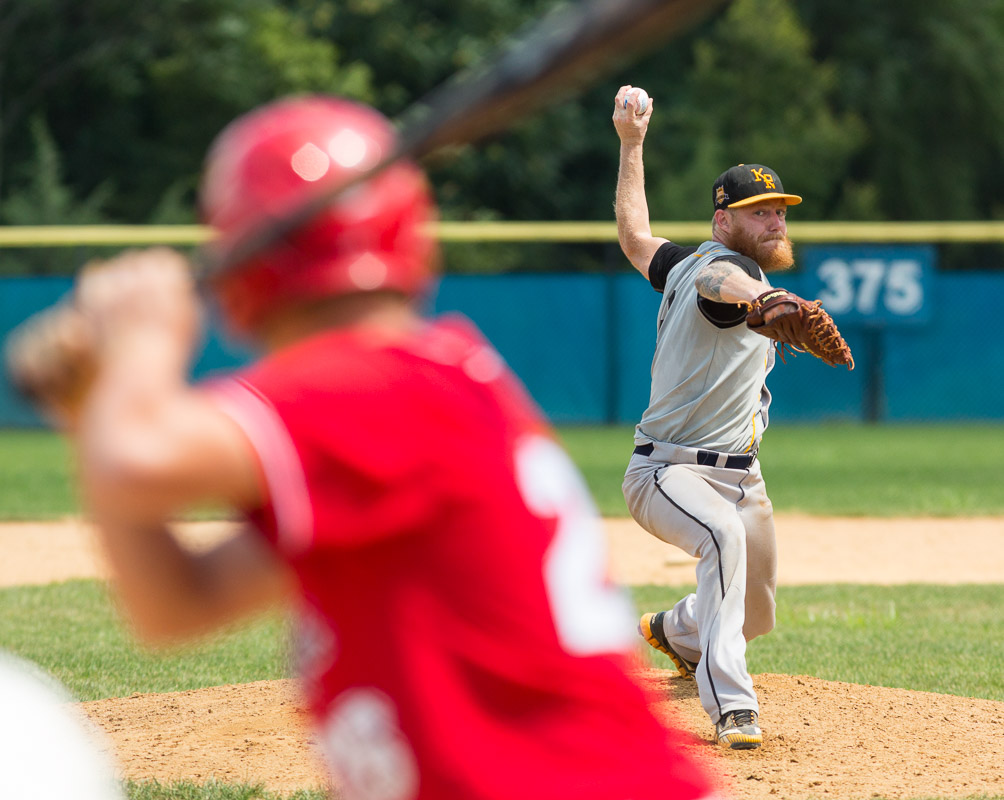 Russel Kessinger pitches for the Kensington Royals against the Muckdogs in the GPMABL playoffs in Glenside, Pa.