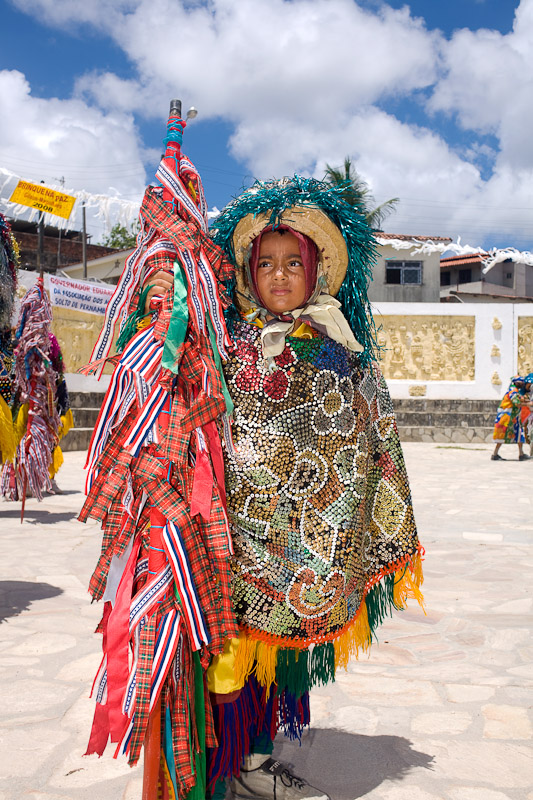 A child dressed in a maracatu rural costume in Recife, Pernambuco.
