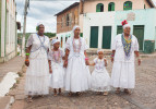 Afro-Brazilian women participate in a religious festival for the patron saint of Lençois, Bahia.