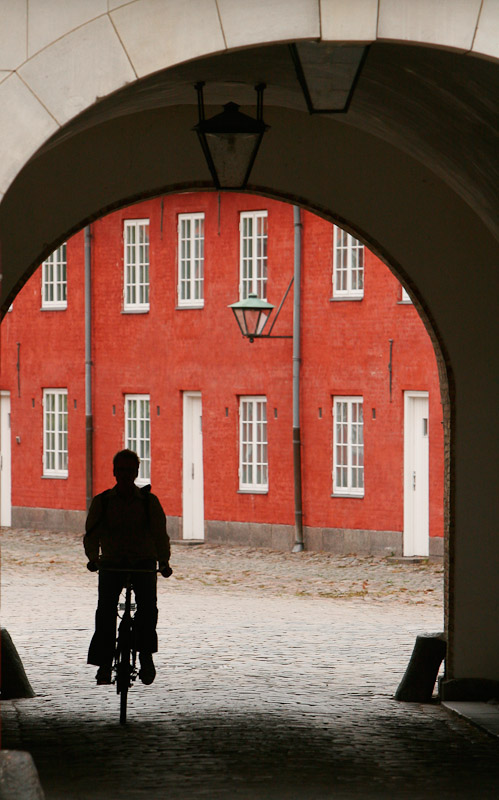 A cyclist passes through an archway at Kastellet, a citadel built by Frederick III in the 1660's in Copenhagen, Denmark.
