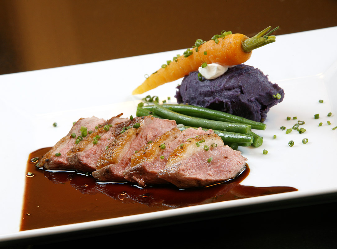 The roast duck with duck jus, haricots vert and an Okinawa sweet potato purée at Meritage Restaurant in Philadelphia.